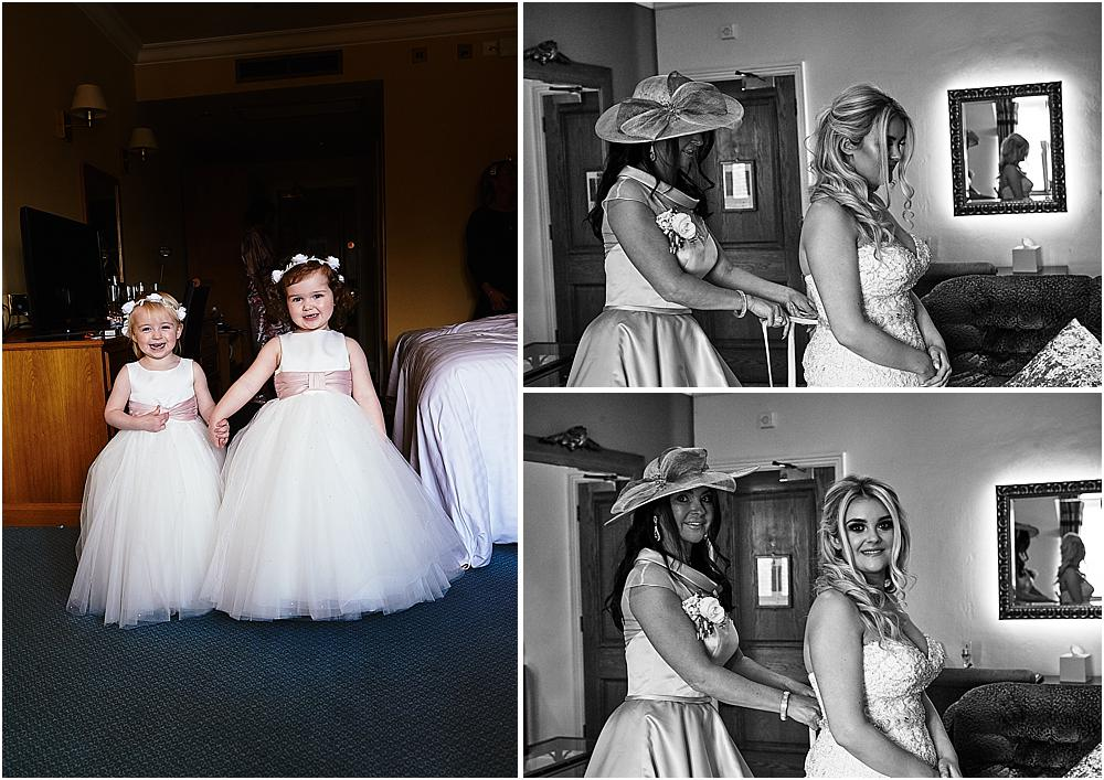 Candid photographs as the bride dresses in her beautiful gown for the wedding at The Moat House in Acton Trussell by Staffordhire Wedding Photographers Barry James