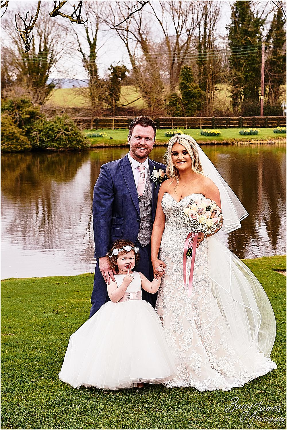 Creative contemporary portraits of the family during the wedding reception at The Moat House in Acton Trussell by Staffordhire Wedding Photographers Barry James