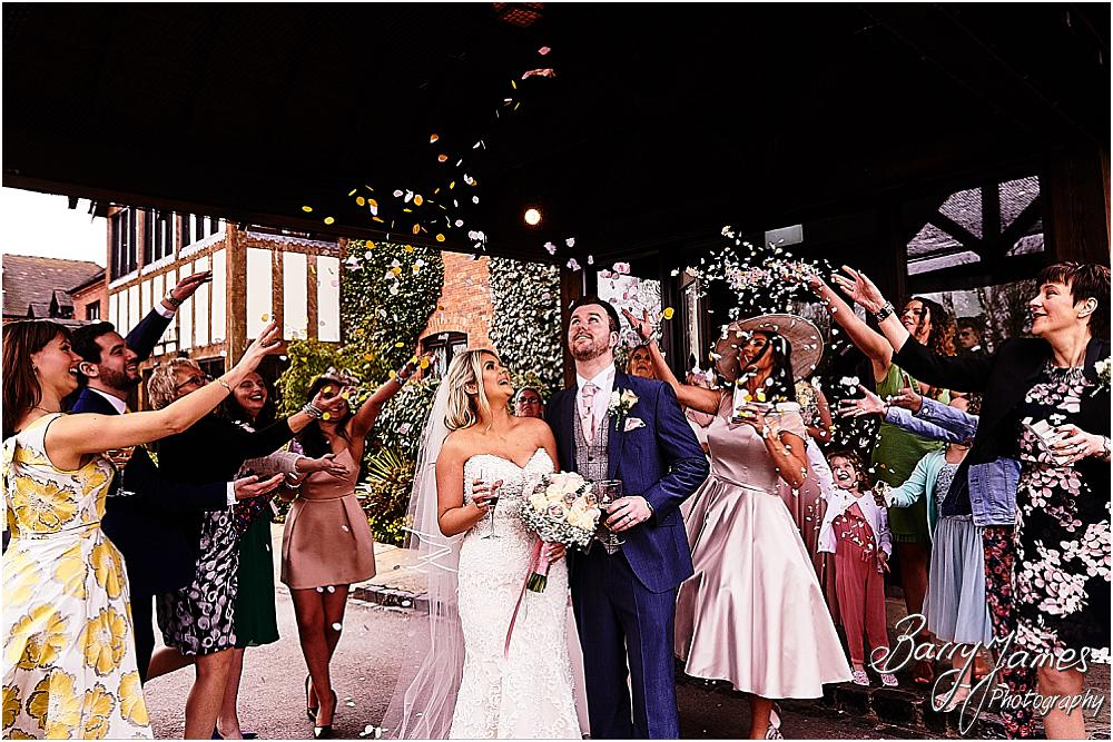 Confetti fun with our bride and groom at The Moat House in Acton Trussell by Staffordhire Wedding Photographers Barry James