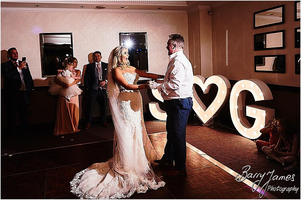Creative timeless photos of the first dance as the evening reception gets underway to the DJ at The Moat House in Acton Trussell by Staffordhire Wedding Photographers Barry James