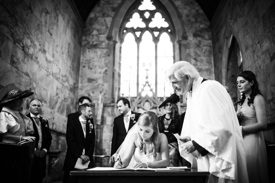 089-candid-photograph-bridal-ceremony-signing