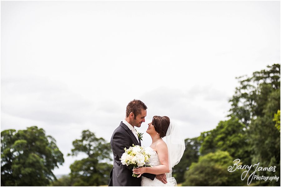 Timeless elegant portraits on the front lawns at Sandon Hall in Staffordshire by Stafford Wedding Photographer Barry James